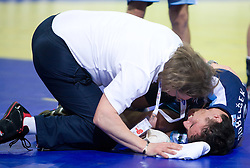 Physiotherapist Gorazd Zuzek with injured Jure Dobelsek of Slovenia during the Men's Handball European Championship Group C match between Slovenia and Poland at the Olympia Hall on January 22, 2009 in Innsbruck, Austria. Slovenia vs. Poland: 30:30. (Photo by Vid Ponikvar / Sportida) - on January 2010