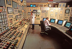 Operators and Engineers operating computerized Industrial Electronics