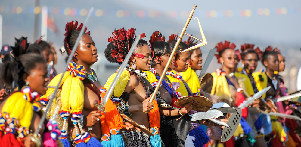 Ludzidzini, Swaziland, Africa - Annual Umhlanga, or reed dance ceremony, in which up to 100,000 young Swazi women gather to celebrate their virginity and honor the queen mother during the 8 day long event.<br /> Princesses dance before King Mswati III on day 7 of the ceremony