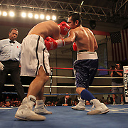 """Former WBO World champion Alex """"El Nene"""" Sanchez (White Trunks) of Ponce, Puerto Rico fights with Glen Donaire (Blue Trunks) of the Philippines in a bout scheduled for 12 Rounds with the WBC Latin Flyweight Title on the line at the Kissimmee Civic Center in Kissimmee, Florida, on Friday, Dec 9, 2011.  Donaire won the bout when Sanchez injured his left wrist and failed to come out in the ninth round. (AP Photo/Alex Menendez)"""