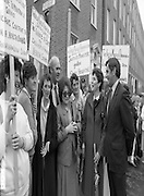 Irish Nurses Organisation Protest..28.05.1986..05.28.1986..28th May 1986..In protest against proposed health cuts the Irish Nurses Organisation organised a protest march to Dail Eireann. Nurses from all over Ireland were represented at the march...Photo of Mr Ray Mc Sharry TD,Fianna Fail,Speaks with nurses representing Co Sligo INO.