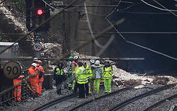 © Licensed to London News Pictures. 16/09/2016. Watford, UK. A landslide can be seen at the entrance to a tunnel where a train has derailed near Watford, following heavy rainfall over night. Photo credit: Peter Macdiarmid/LNP