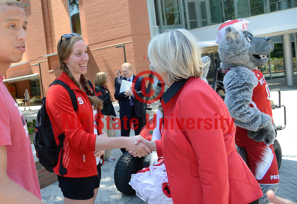 Ms. Spellings meets with a student outside of the Talley Student Union on NC State's campus.