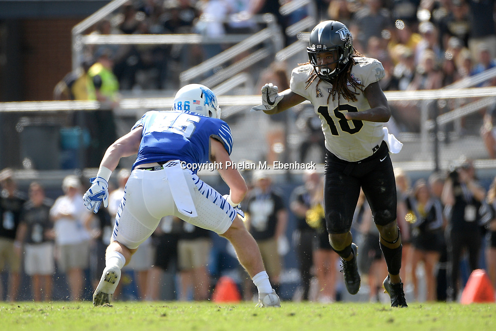 Central Florida linebacker Shaquem Griffin (18) sets up for a play in front of Memphis tight end Joey Magnifico (86) during the first half of the American Athletic Conference championship NCAA college football game Saturday, Dec. 2, 2017, in Orlando, Fla. (Photo by Phelan M. Ebenhack)