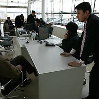 BEIJING, APRIL-22, 2010:  a customer (L) talks to a salesman (R) at the  BMW dealership .