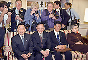 The White House press photographers stand behind Chinese officials during the meeting of President Bill Clinton and Chinese Premier Zhu Rongji in the Oval Office at the White House April 8, 1999 in Washington D.C.