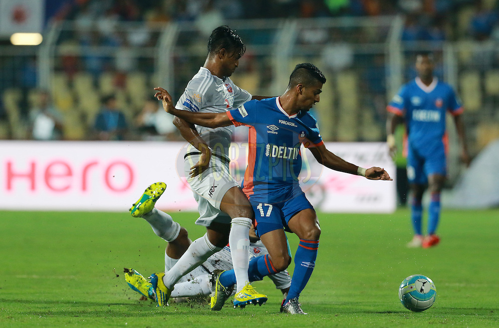 Mandarrao Dattarao Dessai of FC Goa tries to get past the defence of FC Pune City during match 8 of the Indian Super League (ISL) season 3 between FC Goa and FC Pune City held at the Fatorda Stadium in Goa, India on the 8th October 2016.<br /> <br /> Photo by Vipin Pawar / ISL/ SPORTZPICS