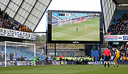 Brighton and Hove Albion defender Lewis Dunk (5) shoots and scores a penalty in the shoot out past Millwall goalkeeper Ben Amos (13) during the The FA Cup quarter final match between Millwall and Brighton and Hove Albion at The Den, London, England on 17 March 2019.