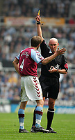 Fotball<br /> Premier League 2004/05<br /> Newcastle v Aston Villa<br /> 2. april 2005<br /> Foto: Digitalsport<br /> NORWAY ONLY<br /> Aston Villa's Olof Mellberg (L) is booked by the referee, Barry Knight (R).