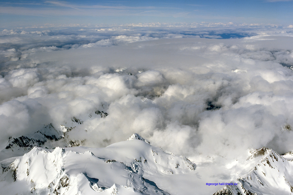 Stratocumulus clouds over snow covered mountain tops