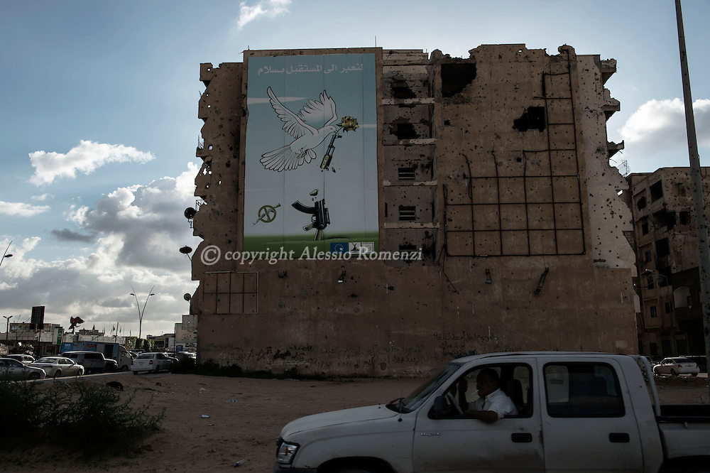 Libya, Misurata: view of a partially destroyed building in Misurata.<br /> The banner says &quot; let's move to the future in peace&quot;.<br /> Alessio Romenzi