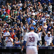 Fans watching pitcher Matt Harvey, New York Mets,  striking out Giancarlo Stanton, Miami Marlins, during the New York Mets Vs Miami Marlins MLB regular season baseball game at Citi Field, Queens, New York. USA. 19th April 2015. Photo Tim Clayton