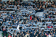 Victory fans hold up scarves at the Hyundai A-League Round 2 soccer match between Melbourne Victory and Perth Glory at AAMI Park in Melbourne.
