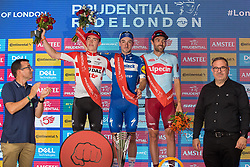 London, UK. 4 August, 2019. Elia Viviani (c) of Deceuninck-Quick-Step celebrates after winning the Prudential RideLondon Classic with Alex Dowsett (r) of Team Katusha Alpecin who won the King of the Mountains award and Stan Dewulf (l) of Lotto Soudal who won the Combattivity award. The Prudential RideLondon Classic is Britain's only men's UCI WorldTour race and the richest one-day race in the world with a prize pot of 100,000 Euros on offer. This year's race features a redesigned race route from a start in Bushy Park in south-west London through Surrey, including a five-lap circuit of Box Hill, to a finish on the Mall.