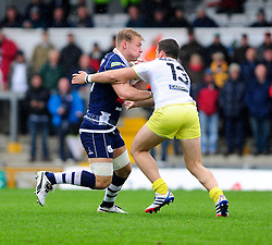 Bristol Rugby Number 8 (#8) Mitch Eadie is challenged by Leeds Carnegie Outside Centre (#13) Peter Lucock - Photo mandatory by-line: Dougie Allward/JMP - Tel: Mobile: 07966 386802 13/10/2013 - SPORT - FOOTBALL - RUGBY UNION - Memorial Stadium - Bristol - Bristol Rugby v Leeds Carnegie - B&I Cup