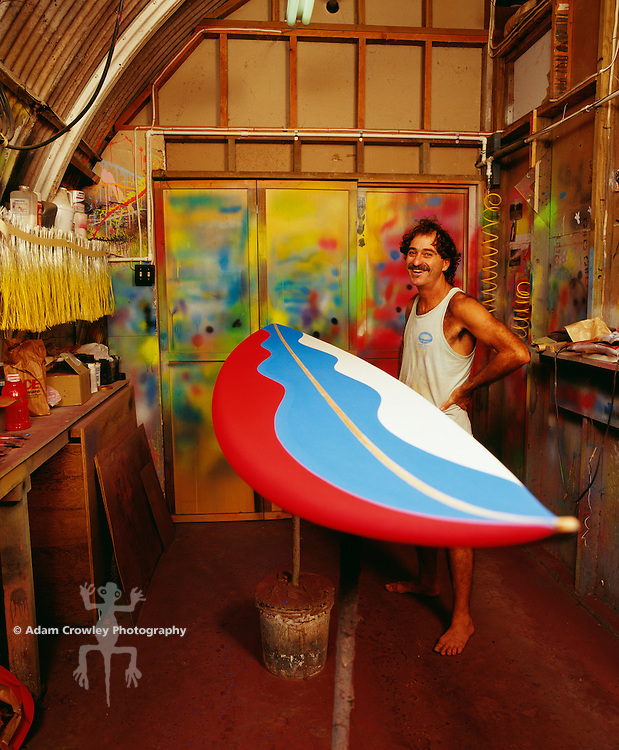 Rick Holt, surfboard designer & airbrusher, in his painting studio