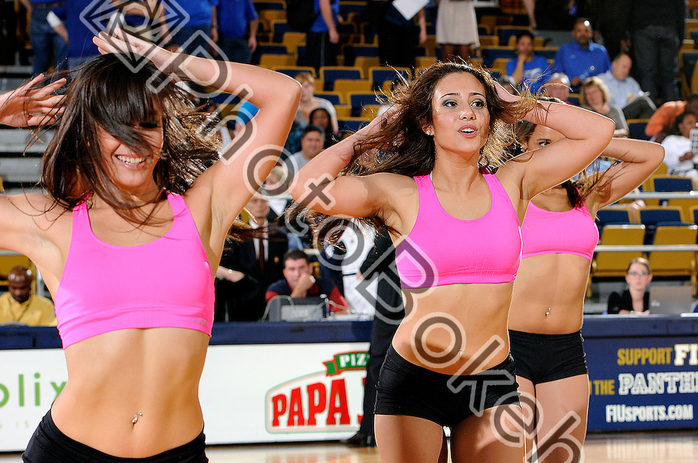 2012 January 12 - FIU Golden Dazzlers dance team performing for the crowd. Florida International University fell to Middle Tennessee State University, 70-59, at the U.S. Century Bank Arena, Miami, Florida. (Photo by: www.photobokeh.com / Alex J. Hernandez) 1/250 f/5.6 ISO400 105mm