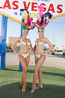 Female dancers posing in front of Las Vegas welcome sign, Nevada, USA