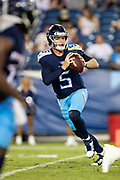 NASHVILLE, TN - AUGUST 17:  Logan Woodside #5 of the Tennessee Titans rolls out to pass during a game against the New England Patriots during week two of the preseason at Nissan Stadium on August 17, 2019 in Nashville, Tennessee.  The Patriots defeated the Titans 22-17.  (Photo by Wesley Hitt/Getty Images) *** Local Caption *** Logan Woodside