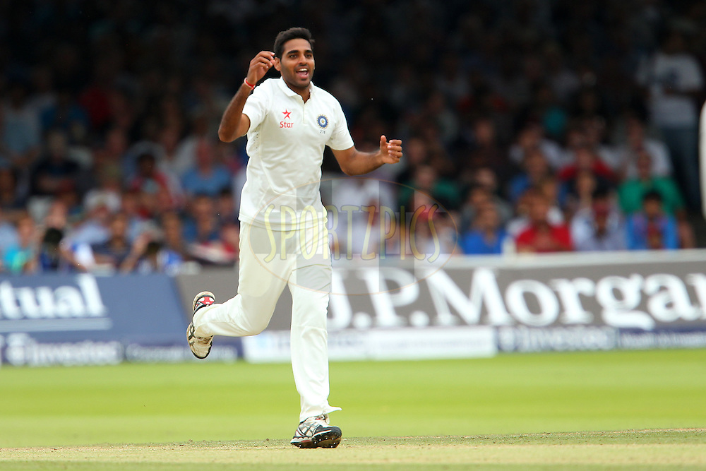 Bhuvaneshwar Kumar of India celebrates the wicket of Ben Stokes of England during day three of the 2nd Investec test match between England and India held at Lords cricket ground in London, England on the 19th July 2014<br /> <br /> Photo by Ron Gaunt / SPORTZPICS/ BCCI