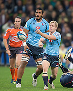 Matt Lucas (Waratahs) passing during the Round 15 match of the 2013 Super Rugby Championship between RaboDirect Rebels vs HSBC Waratahs at AAMI Park, Melbourne, Victoria, Australia. 24/05/0213. Photo By Lucas Wroe