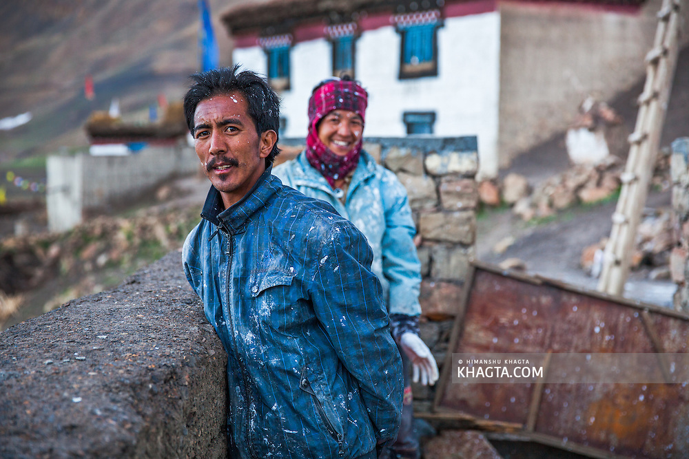 Two friends painting their new house in Demul village, Spiti.