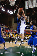 November 27th, 2010:  Anchorage, Alaska - Weber State senior center Trevor Morris (55) grabs a rebound in the Wildcat's 82-81 win over the Drake Bulldogs in the third place game of the Great Alaska Shootout.