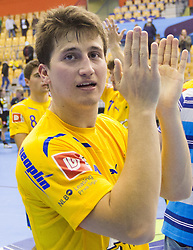 David Razgor of Celje  celebrates after the handball match between RK Celje Pivovarna Lasko and IK Savehof (SWE) in 3rd Round of Group B of EHF Champions League 2012/13 on October 13, 2012 in Arena Zlatorog, Celje, Slovenia. (Photo By Vid Ponikvar / Sportida)
