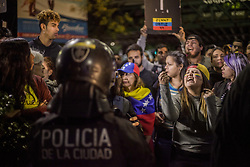 April 30, 2019 - Buenos Aires, Federal Capital, Argentina - Venezuelan migrants residing in the city of Buenos Aires moved to the Venezuelan Embassy in the Capital City to express their support for the leaders of the Venezuelan opposition, Juan Guaido and Leopoldo Lopez, at the same time they made strong confrontations in the Venezuelan capital. The Venezuelan Embassy in La Ciudad Porte also presented leftist organizations and sympathizers of Nicolas Maduro who repudiated the events that took place in Venezuela. (Credit Image: ©  Roberto Almeida Aveledo/ZUMA Wire)