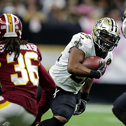 Oct 8, 2018; New Orleans, LA, USA New Orleans Saints running back Mark Ingram II (22) runs past Washington Redskins safety D.J. Swearinger (36) during the fourth quarter at the Mercedes-Benz Superdome. The Saints defeated the Redskins 43-19.