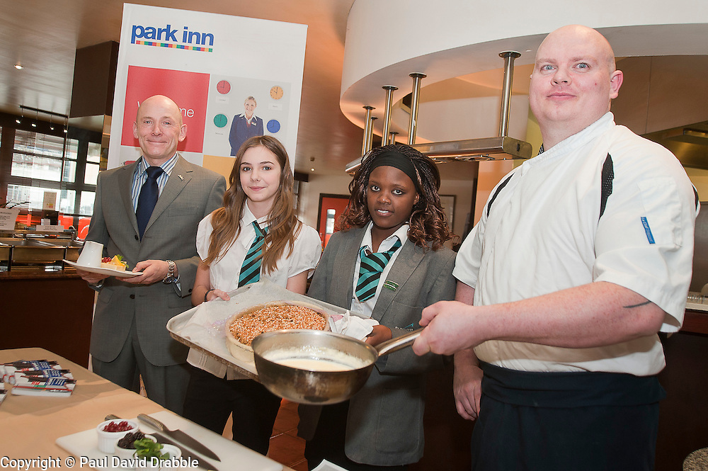"""Hospitality Sheffield's """"Spring Forward"""" initiative aimed at attracting the next generation of hospitality professionals took place in Sheffield on Thursday 8th March. Lindi Dube and Chloe Hollingsworth of Parkwood Academy with Park Inn General Manager Ian Slater and Head chef John MacGregor..http://www.pauldaviddrabble.co.uk.3  March 2012.Image © Paul David Drabble"""