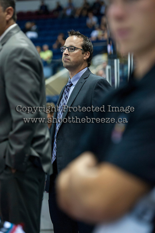 KELOWNA, CANADA - AUGUST 30:  Kris Mallette, Assistant Coach of the Kelowna Rockets stands on the bench opposite the Kamloops Blazers on August 30, 2014 during pre-season at Prospera Place in Kelowna, British Columbia, Canada.   (Photo by Marissa Baecker/Shoot the Breeze)  *** Local Caption *** Kris Mallette;