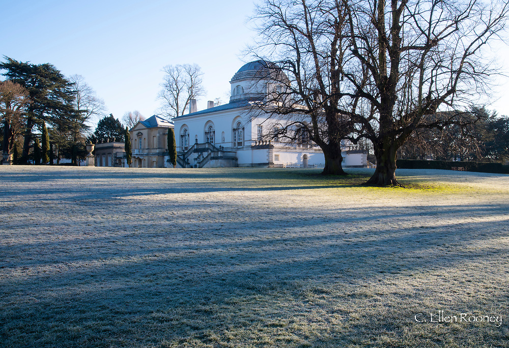 Frost covered lawn on a February morning in front of Chiswick House, a neo-Palladian villa. Chiswick, London, UK