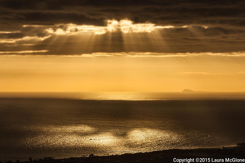 Hawaii Sun beams streaming down on ocean water