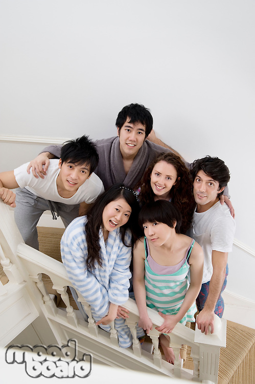 Young friends posing on stairway
