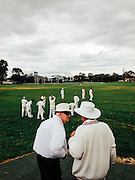 Two cricket umpires about to umpire a game of park cricket in South East Melbourne suburb of Noble Park