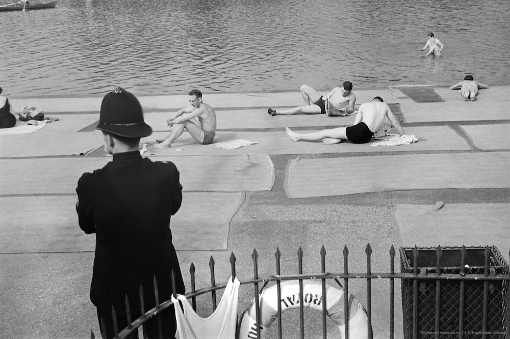 Policemen Overlooking Swimmers and Sunbathers, London, 1935