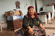 Karamatjon Yakubova, 73, poses for a photograph at her family compound in Bazar Korgon (Jalal-Abad province, Kyrgyzstan).