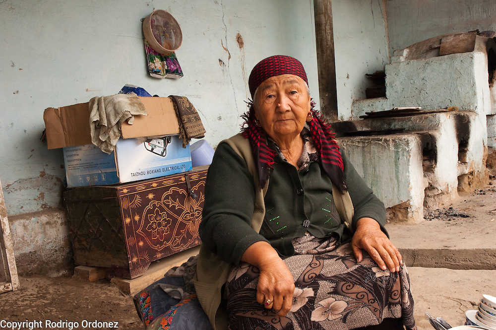 Karamatjon Yakubova, 73, poses for a photograph at her family compound in Bazar Korgon (Jalal-Abad province, Kyrgyzstan).