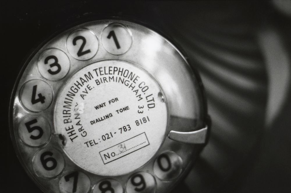 old British telephone dial with Birmingham telephone number