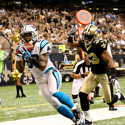 January 1, 2012; New Orleans, LA, USA; Carolina Panthers wide receiver Steve Smith (89) catches a touchdown over New Orleans Saints cornerback Jabari Greer (33) during the first quarter of a game at the Mercedes-Benz Superdome. Mandatory Credit: Derick E. Hingle-US PRESSWIRE