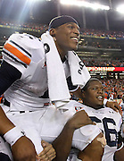 ATLANTA - DECEMBER 04:  Quarterback Cam Newton #2 of the Auburn Tigers is carried on the field after the 2010 SEC Championship against the South Carolina Gamecocks at Georgia Dome on December 4, 2010 in Atlanta, Georgia.  The Tigers beat the Gamecocks 56-17.  (Photo by Mike Zarrilli/Getty Images)