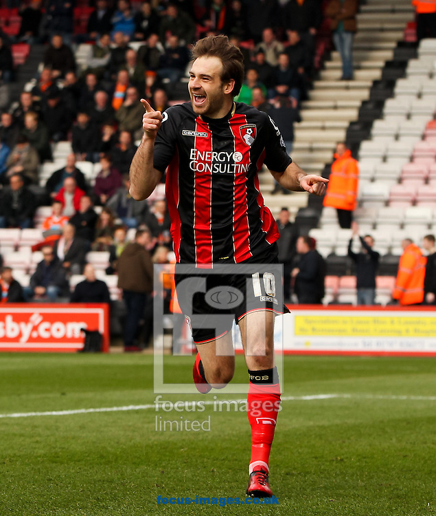 Brett Pitman of Bournemouth celebrates scoring his sides first goal during the Sky Bet Championship match at the Goldsands Stadium, Bournemouth<br /> Picture by Tom Smith/Focus Images Ltd 07545141164<br /> 14/03/2015