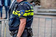 DEN HAAG - overgewicht , buik , dikke politie agent agenten op het binnenhof politiek beveiligen , beveiliging , marechaussee toerist , toeristen  robin utrecht  <br /> DEN HAAG - politie agent agenten op het binnenhof politiek beveiligen , beveiliging , marechaussee toerist , toeristen Robin Utrecht<br /> Trefwoorden<br /> aanwijzingen   act   Act of violence   Actie   action   actof   actof violence   Aerospace   Airfield   airport   airport terrains   alert   alertheid   Algemene   angst   animal   Animal figure   animalia   animals   anxiety   arrestatie   arrestatieteam   aviation   bescherming   BEVEILIGING   beveiligingsmaatregelen   bewaking   bezorgdheid   bomaanslagen   bommen   Brussel   brussels   cab   Cabs   canine   check    checkup   closed   concern   control   controle   controleren   controlling   crime   crime of violence   criminal   criminal act   criminaliteit   crisisbeheersing   danger   Dier   Dieren   DIERENRIJK   dog   DREIGING   dreigingsniveau   dutch   eenheid   entrance   Expert   explosieven   extremism   extremisme   fear   Fears   figure   flee   fleeing   flights   Fright   geannuleerd   Gesloten   Gevaar   gevolgen   Geweld   hazard   Hazzard   hinder   holland   Hond   house   house dog   Hulpdiensten   in   indicatie   indication   ingang   Inquiry   investigation   K9   KLM   kogelwerend   Koninklijke   locked   locked up   Luchthaven   luchtvaart   luchtvaartverkeer   maart   maatregelen   march   Marechaussee   marechaussees   melding   Misdaad   misdrijf   mogelijke   moordaanslagen   moslimextremisme   naar   Nederland   Nederlandse   Netherlands   of   official   officiele   officiele taxi   on   onderzoek   ontruiming   op   oponthoud   politiehond   portal   preventie   preventief   preventieve   prevention   protection   research   safety   safety hazard   samenleving   Schiphol   security   snuffelhond   speciale   Speurhond   springstof   standplaats   substantieel   surveillance   taxi   taxi cab   Taxi cabs   terra