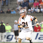 Ethan Vedder #21 of the Denver Outlaws runs in the the rain during the game at Harvard Stadium on May 10, 2014 in Boston, Massachusetts. (Photo by Elan Kawesch)