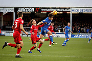 Peterborough United midfielder Alex Woodyard (4) wins this header during the EFL Sky Bet League 1 match between Peterborough United and Walsall at London Road, Peterborough, England on 22 December 2018.