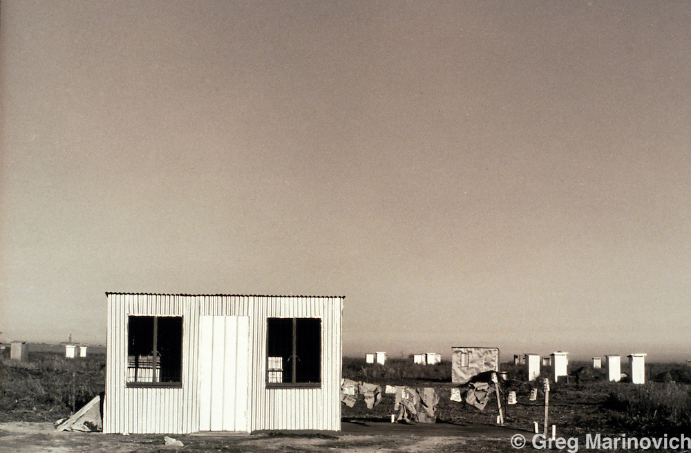 Diepsloot, Soweto, Johannesburg, Transvaal, South Africa, 1991: A newly erected shack the shacks and shelters of people trying to squat on open land earmarked for more formal development.