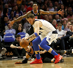 February 25, 2019 - Los Angeles, California, U.S - Dallas Mavericks' Luka Doncic (77) controls the ball as Los Angeles Clippers' Garrett Temple (17) falls on the floor during an NBA basketball game between Los Angeles Clippers and Dallas Mavericks Monday, Feb. 25, 2019, in Los Angeles. (Credit Image: © Ringo Chiu/ZUMA Wire)