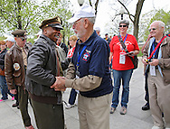 National Parks worker John McCaskill (from left) greets World War II Veteran Jack Swisher of Clarinda during the Sullivan-Hartogh-Davis Post 730 Honor Flight at the National World War II Memorial in Washington, DC on Tuesday, April 16, 2013. About 90 veterans were on the trip. After their visit to the National World War II Memorial they would take a bus tour of Washington, DC followed by a visit to the Korean War Veterans Memorial.