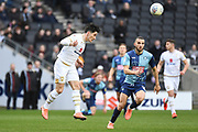 Milton Keynes Dons defender George Williams (2) heads the ball  under pressure from Wycombe Wanderers midfielder Nick Freeman (22) during the EFL Sky Bet League 1 match between Milton Keynes Dons and Wycombe Wanderers at stadium:mk, Milton Keynes, England on 1 February 2020.